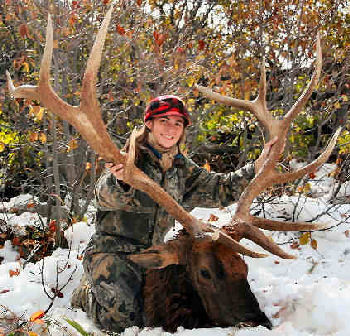 as she proudly shows off her first bull elk. Taken near Jackson Hole
